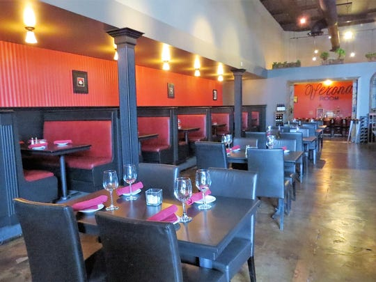 Tables and booths offer seating in the dining room at Julian's Restaurant & Bar in Camarillo. The semi-private Verona Room seen in the background is a reminder of the family-owned restaurant's roots in the area.