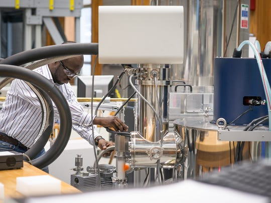 Mag Lab scientist Adewale Akinfaderin works on an experiment in the lab.