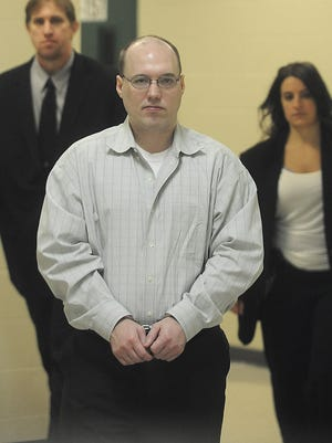 Christopher Kryger is escorted to Minnehaha County Court on Nov. 5.