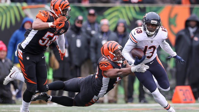 Cincinnati Bengals outside linebacker Vincent Rey (57) tackles Chicago Bears wide receiver Kendall Wright (13) in the second quarter during the Week 14 NFL game between the Chicago Bears and the Cincinnati Bengals, Sunday, Dec. 10, 2017, at Paul Brown Stadium in Cincinnati. At the half, Chicago leads 12-7.