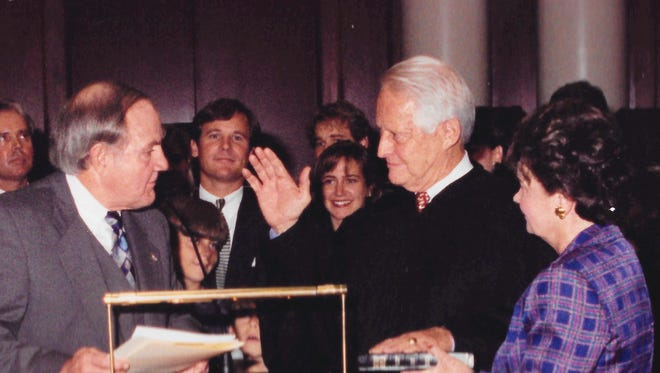 Chief Justice Perry O. Hooper Sr. is sworn in by Gov. Fob James on Oct. 20, 1995. Hooper, who died Sunday at age 91, was the first Republican elected as Alabama Chief Justice since Reconstruction.
