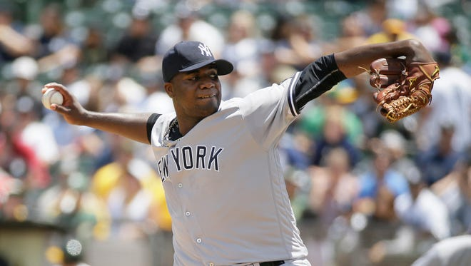 New York Yankees starting pitcher Michael Pineda throws in the first inning of a baseball game against the Oakland Athletics Sunday, May 22, 2016, in Oakland, Calif.