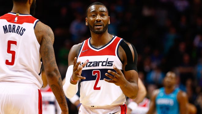Washington Wizards guard John Wall reacts to a foul call in the second half against the Charlotte Hornets at Spectrum Center.