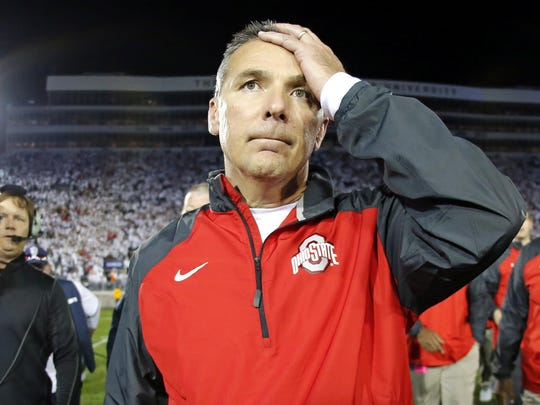 Ohio State coach Urban Meyer walks off after his team's 31-24 double-overtime win against Penn State last season. OSU benefited from a bad review call in the game.