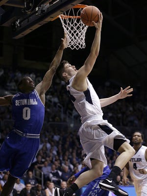 Butler Bulldogs guard Kellen Dunham (24) lays in a shot around Seton Hall Pirates guard Khadeen Carrington (0) in the second half of their game Wednesday, Mar 2, 2016, evening at Hinkle Fieldhouse in Indianapolis. The Butler Bulldogs defeated the Seton Hall Pirates 85-78.
