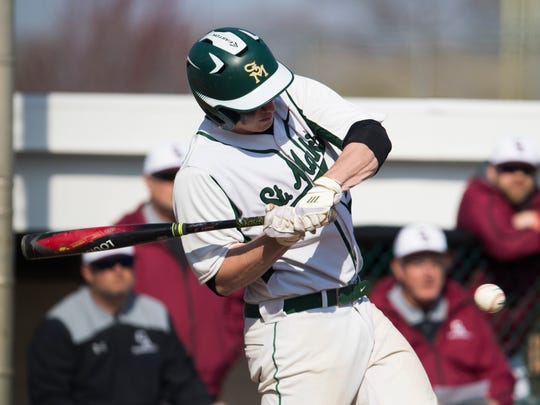 Justin Tomovich takes a swing for St. Mark's High.