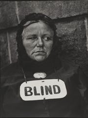 Blind Woman, New York, 1916 (negative); 1945 (print). Paul Strand, American, 1890 - 1976. Gelatin silver print, Image: 12 3/4 × 9 3/4 inches (32.4 × 24.8 cm) Sheet: 13 9/16 × 10 11/16 inches (34.5 × 27.2 cm). The Paul Strand Collection, partial and promised gift of Marguerite and Gerry Lenfest, 2009. ? Paul Strand Archive/Aperture Foundation