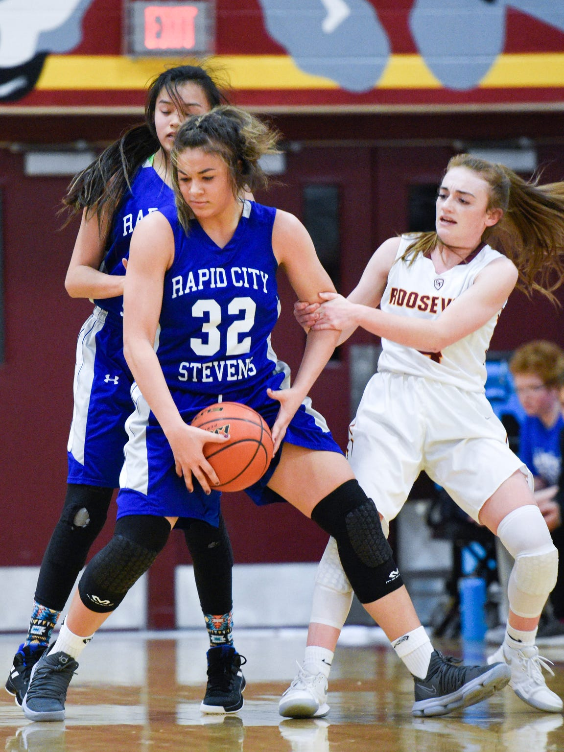 Rapid City Central guard Kyah Watson (32) gets fouled by Roosevelt's Hattie Giblin (4) at Roosevelt High School on Friday, Jan. 19, 2018. Rapid City Stevens beat Roosevelt 45-30.