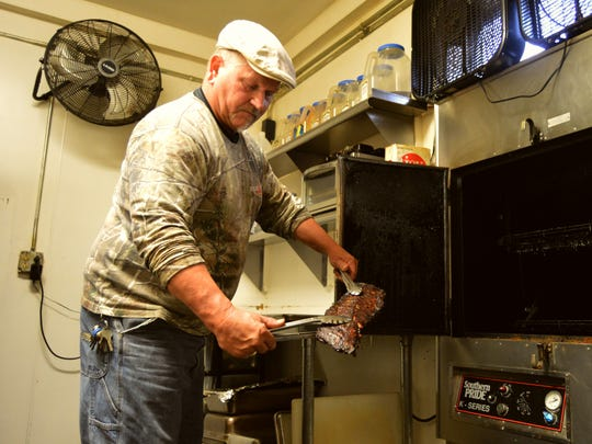 Jeffrey Frey pulls out a tender piece of meat from his state-of-the-art smoker. His barbecue restaurant, Fat Daddy's has been rated one of the best in America.