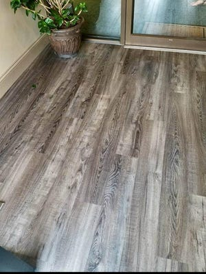 Luxury vinyl plank is a popular choice for homeowners looking for water-resistant flooring options that give the appearance of wood. Often used in bathrooms and basement family rooms, LVP is easy to maintain and doesn't have grout joints, making it more waterproof than real hard wood or engineered hard wood.