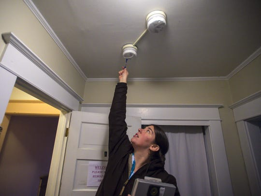 Burlington housing inspector Kim Ianelli tests smoke detectors in an apartment on Wednesday, February 3, 2016.