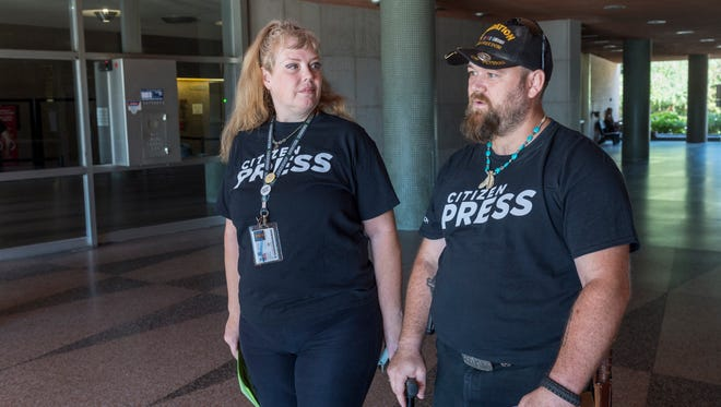 Amy Dickinson Campbell, left, and Eric Campbell, members of the New California State Movement, read grievances at the Tulare County Courthouse on Tuesday, June 19, 2018. The group has objections to the way the State is run and wants to break the state into three states.