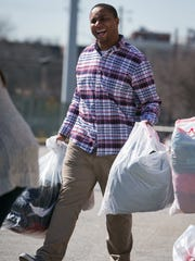 Eric Smith, 25, drops off bags of clothes at The Clothing Bank of Delaware which he and co-founder Caitlynn Houser collected in a two week drive on Facebook called The Give Back Challenge. Smith and Houser created a local organization called the Charity Company with a mission to reshape and rebuild our local communities.