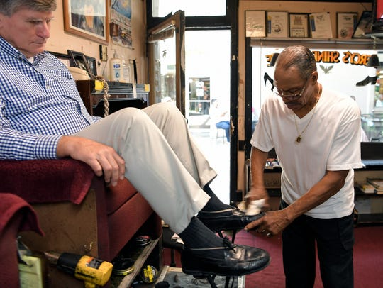 """Robert """"Percy"""" Person shines John Marcum's shoes at"""