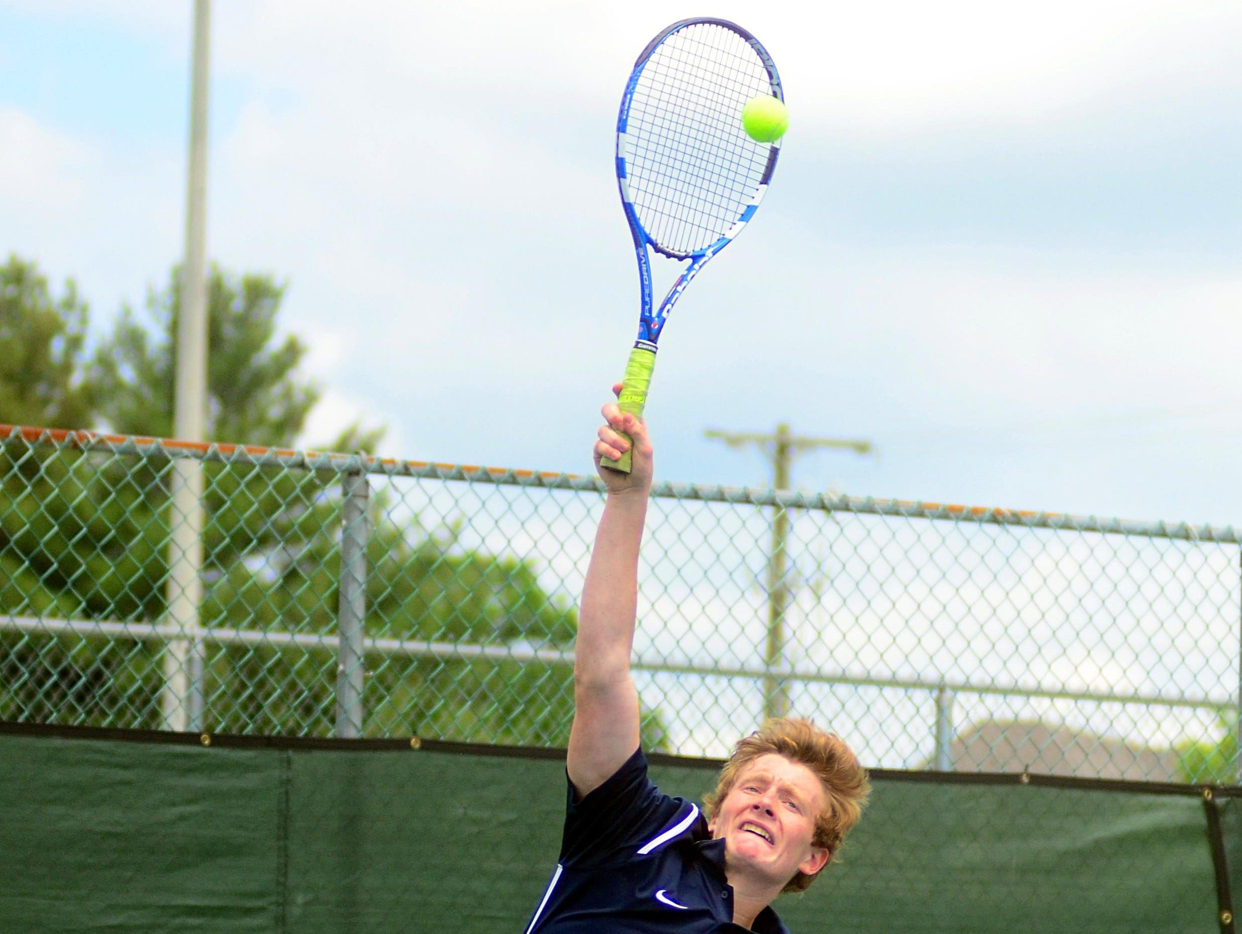 Beech High senior Robert Balgemann hits a serve during his first-round singles match on Tuesday at the District 9-AAA Individual Tennis Tournament. Balgemann advanced to the semifinals before suffering a straight-set loss to Station Camp senior Nathan Watson.