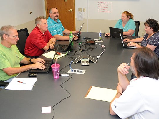 Renaissance Learning software employees take part in a meeting at the Research and Development building.