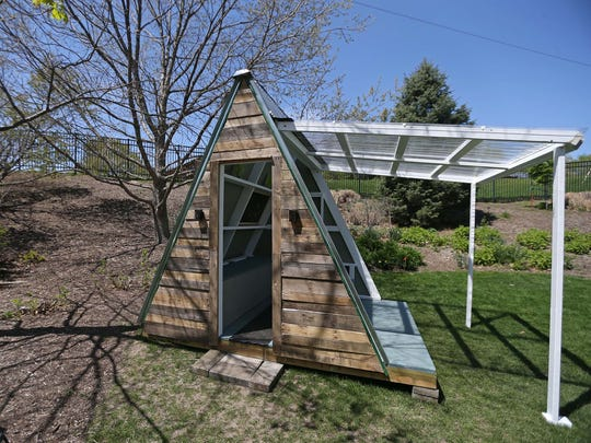 The tree house, 1872 Arbor Day Lane by Scott Rummery at Reiman Gardens in Ames on Tuesday, May 5, 2015. The house is based on tiny, livable A-frame homes that have become popular in the tiny house movement.