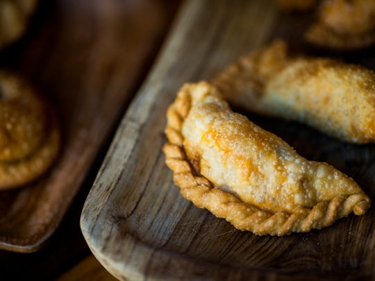 CheŽ is an Argentinian-owned and operated bar and restaurant on Walnut Street in Cincinnati that serves artisanal empanadas.