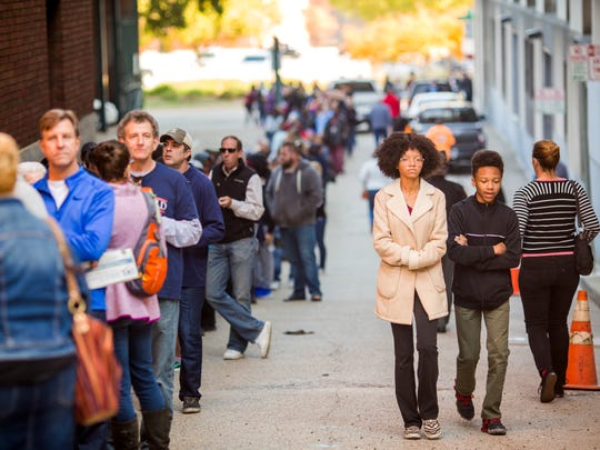 Hundreds stand in line to vote early at the Hamilton
