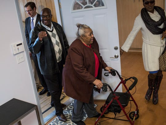"February 2, 2017 - Army Veteran Walter Moody, left, and his mother, Mary Moody, enter their new home in Raleigh for the first time following a ribbon cutting ceremony. The home was part of a ""Home Today, Home Tomorrow"" design challenge that has been retrofitted to be model for aging-in-place designs."