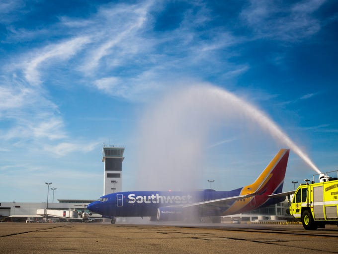 The CVG fire department sprays water over the first