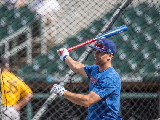 Jacob Hannemann, outfielder for the I-Cubs works out