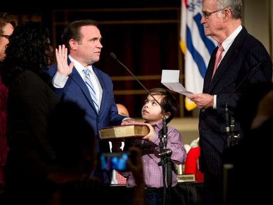 Joseph Cranley holds the bible as his father Mayor