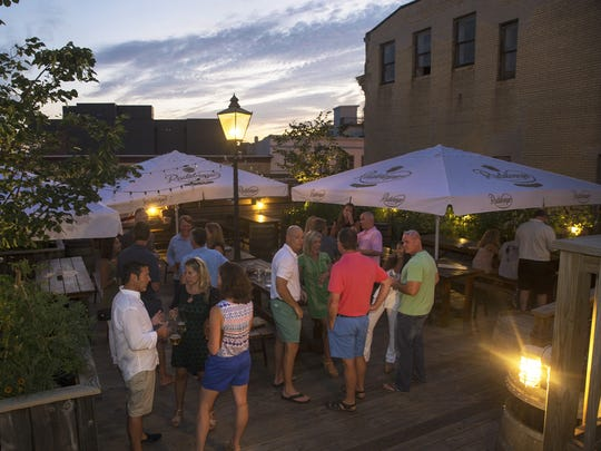 Visitors to the Asbury Festhalle and Biergarten enjoy