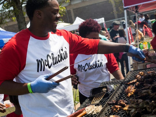 Dwayne McCray cooks hot wings during the 2018 Southern Hot Wing Festival at Tiger Lane. This year's festival is set for April 13.