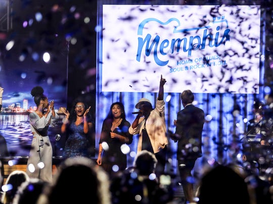 """June 21, 2018 - Alphonzo Bailey, better known by his stage name Al Kapone, points up to the new slogan that tourism boosters unveiled Thursday that adds a dash of soul to a 1995 tagline that has more than stood the test of time. The new slogan, """"Memphis: Home of Blues, Soul & Rock 'N' Roll,"""" replaces """"Memphis: Home of the Blues, Birthplace of Rock 'N' Roll."""""""