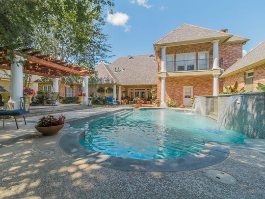 The gorgeous pool at the 4 bedroom, 2½ bathroom home in Broussard, Louisiana, is perfect for entertaining. The mansion is listed at $879,900.