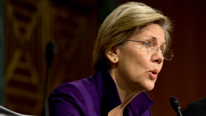 Sen. Elizabeth Warren, D-Mass., participates at a Senate Banking Committee hearing.