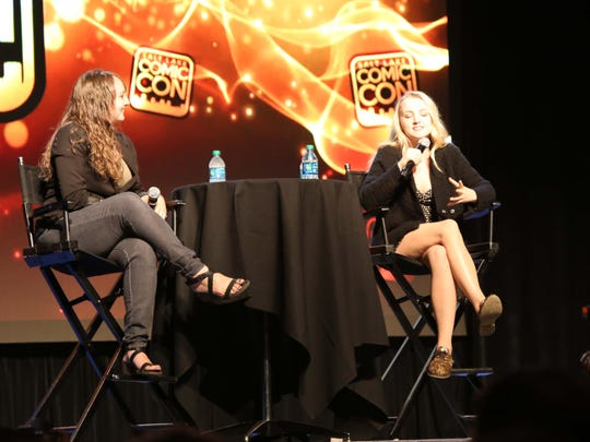 """Moderator McKenzie Romero, left, listens to Evanna Lynch answer a question about what it was like to play Luna Lovegood in the """"Harry Potter"""" films Friday, Sept. 2, 2016, at Salt Lake Comic Con."""