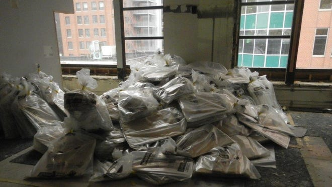 This is some of the materials presumed to contain asbestos that were removed from the building prior to Saturday's fire.