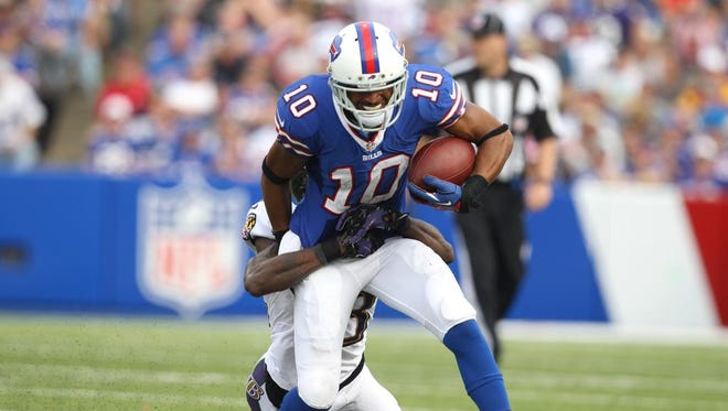 Bills receiver Robert Woods (10) is tackled by Chykie Brown (23).