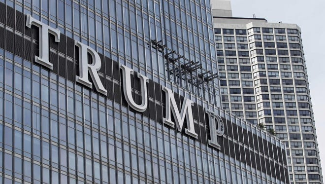 THe 20-foot-tall letters spelling out T-R-U-M-P stand on the side real estate billionaire Donald trump's skyscraper in Chicago, Thursday, June 12, 2014. The letters triggered a war of words between Trump and Chicago Mayor Rahm Emanuel, and led to the mayor introducing a new ordinance on Wednesday Sept. 17, 2014 to limit signage in the Chicago River corridor.