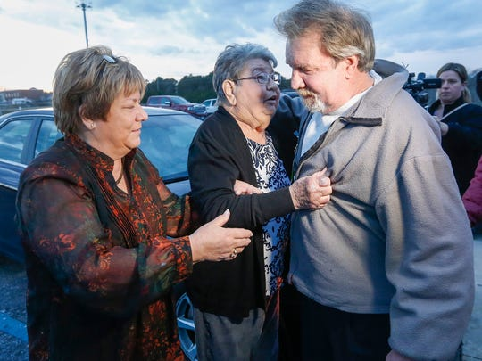 Marsha Iler, left, and Freda Jennings hug Brad Jennings after he was released at the Texas County Jail from the South Central Correctional Center on bond on Friday, Feb. 9, 2018. Iler is his sister and Freda Jennings is his mother.