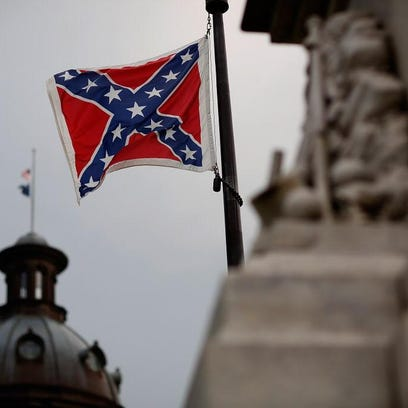 The Confederate flag flies on the Capitol grounds in South Carolina.