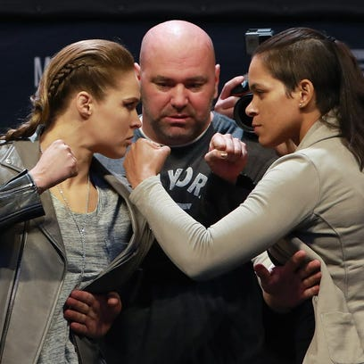 UFC Women's Bantamweight Champion Amanda Nunes faces off with Ronda Rousey after  weigh-ins for UFC 207 fight that will take place on Dec. 30 at Madison Square Garden.