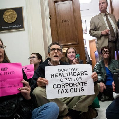 Your Turn: Tax bill is a knife in the backs of Americans