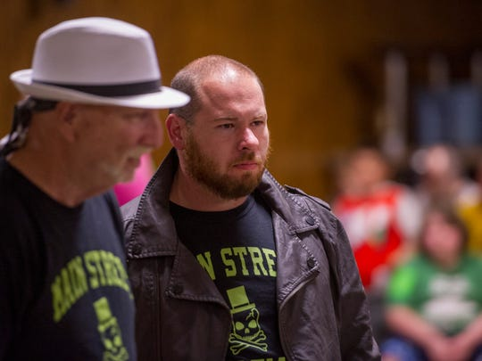 """Tri-State Wrestling Heavyweight Champion Terrance, right, prepares to defend his title with Barry """"Papa"""" Baker at his side at the Vincennes Eagles Lodge Saturday night, March 25, 2017."""