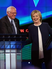 Hillary Clinton and Bernie Sanders shake hands at a Democratic presidential debate in Las Vegas on Oct. 13, 2015.