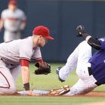Arizona Diamondbacks shortstop Chris Owings, left, makes a late tag as Colorado Rockies' Charlie Blackmon steals second base in the first inning of a baseball game Monday, Aug. 31, 2015, in Denver. (AP Photo/David Zalubowski)