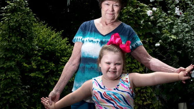 Mary Mahan, 71, stands with her great-ganddaughter Lyric, 4, who she is raising on Monday, Aug. 10, 2020, in Taylor Mill, Kent.