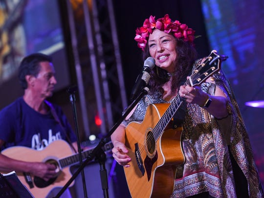Grammy award-winning recording artist Yvonne Elliman gets behind the guitar during her concert at the Dusit Thani Resort Guam on Aug. 19, 2017.
