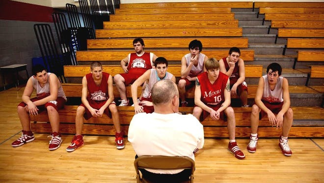 """Assistant coach Rudie Crain talks with the Medora team. The documentary """"Medora"""" follows the down-but-not-out Medora Hornets varsity basketball team over the course of the 2011 season, capturing the players' stories both on and off the court."""