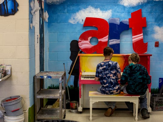 Middle school students Connor Dye and Mitchell Robarge, both 13, play on a piano together in an art classroom Friday, June 2, 2017 at Riverview East High School.