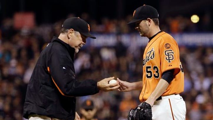 San Francisco Giants starting pitcher Chris Heston, right, is pulled by manager Bruce Bochy, left, during the fourth inning of a baseball game against the Colorado Rockies Friday, Oct. 2, 2015, in San Francisco. (AP Photo/Marcio Jose Sanchez)