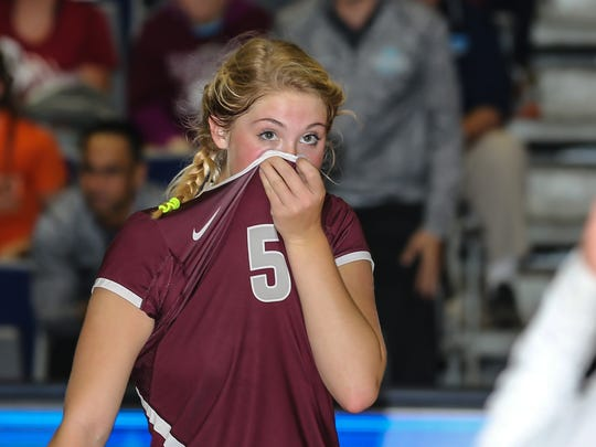 First Baptist Academy's Dani Bradley (5) fights back tears after the fourth and final set of the Girls Volleyball 3A State Championship game at the University of North Florida in Jacksonville, Fla., on Thursday, Nov. 16, 2017.  Christ's Church Academy won 3 of 4 sets for the state championship.  (For The Naples Daily News/Gary Lloyd McCullough)