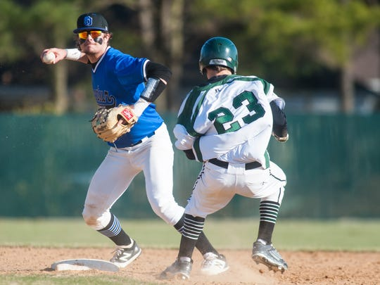 Stephen Decatur shortstop Justin Meekins (7) attempts to turn two as Parkside's Tolan Harrison (23) slides into second at Parkside High School on Tuesday afternoon in Bayside South action.